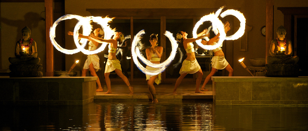 Exotic and alluring fire dancers perform a theatrical show at a Hawaii event